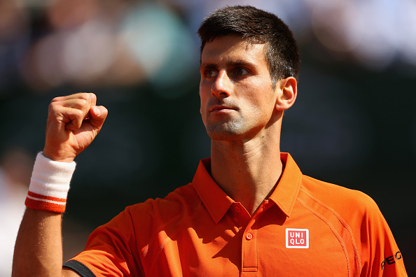 PARIS, FRANCE - JUNE 03:  Novak Djokovic of Serbia celebrates a point in his Men's quarter final match against Rafael Nadal of Spain on day eleven of the 2015 French Open at Roland Garros on June 3, 2015 in Paris, France.  (Photo by Clive Brunskill/Getty Images)