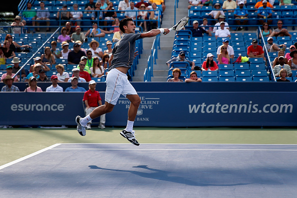 CINCINNATI, OH - AUGUST 19:  Novak Djokovic of Serbia returns a shot to Benoit Paire of France during the Western & Southern Open at the Linder Family Tennis Center on August 19, 2015 in Cincinnati, Ohio.  (Photo by Rob Carr/Getty Images)