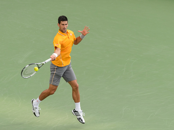 MONTREAL, ON - AUGUST 11:   Novak Djokovic of Serbia returns the ball during day two of the Rogers Cup against  Thomaz Bellucci of Brazil at Uniprix Stadium on August 11, 2015 in Montreal, Quebec, Canada.  Novak Djokovic defeated Thomaz Bellucci 6-3, 7-6.  (Photo by Minas Panagiotakis/Getty Images)