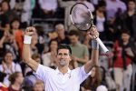 MONTREAL, ON - AUGUST 14:  Novak Djokovic of Serbia celebrates his victory against Ernests Gulbis of Latvia during day five of the Rogers Cup at Uniprix Stadium on August 14, 2015 in Montreal, Quebec, Canada.  Novak Djokovic defeated Ernests Gulbis 5-7, 7-6, 6-1.  (Photo by Minas Panagiotakis/Getty Images)
